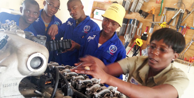 Automotive instructor Helena rebuilds an engine with out-of-school youths on 13 October 2015, as part of KAYEC's life-changing vocational training.