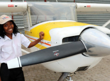Former KAYEC after-school participant Bertha Mawano, 23, shows her pilot's stripes at Eros Airport, 22 August 2015.