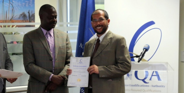 KAYEC Director Nelson Prada (right) receives accreditation from NQA council member Vitura Kavari, 11 December 2015