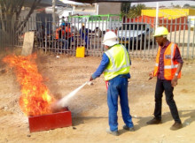 Petrus Thomas (right), founder and owner of BIC training, leads onsite training on industrial firefighting with Valleis Property and Renovation construction company in Khomasdal, September 2015.