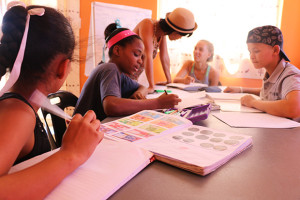 KAYEC kids work on their maths with Youth Officer Riana Gaoes, November 2015.