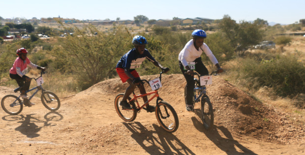 The 14-and-under boys negotiate the berms.